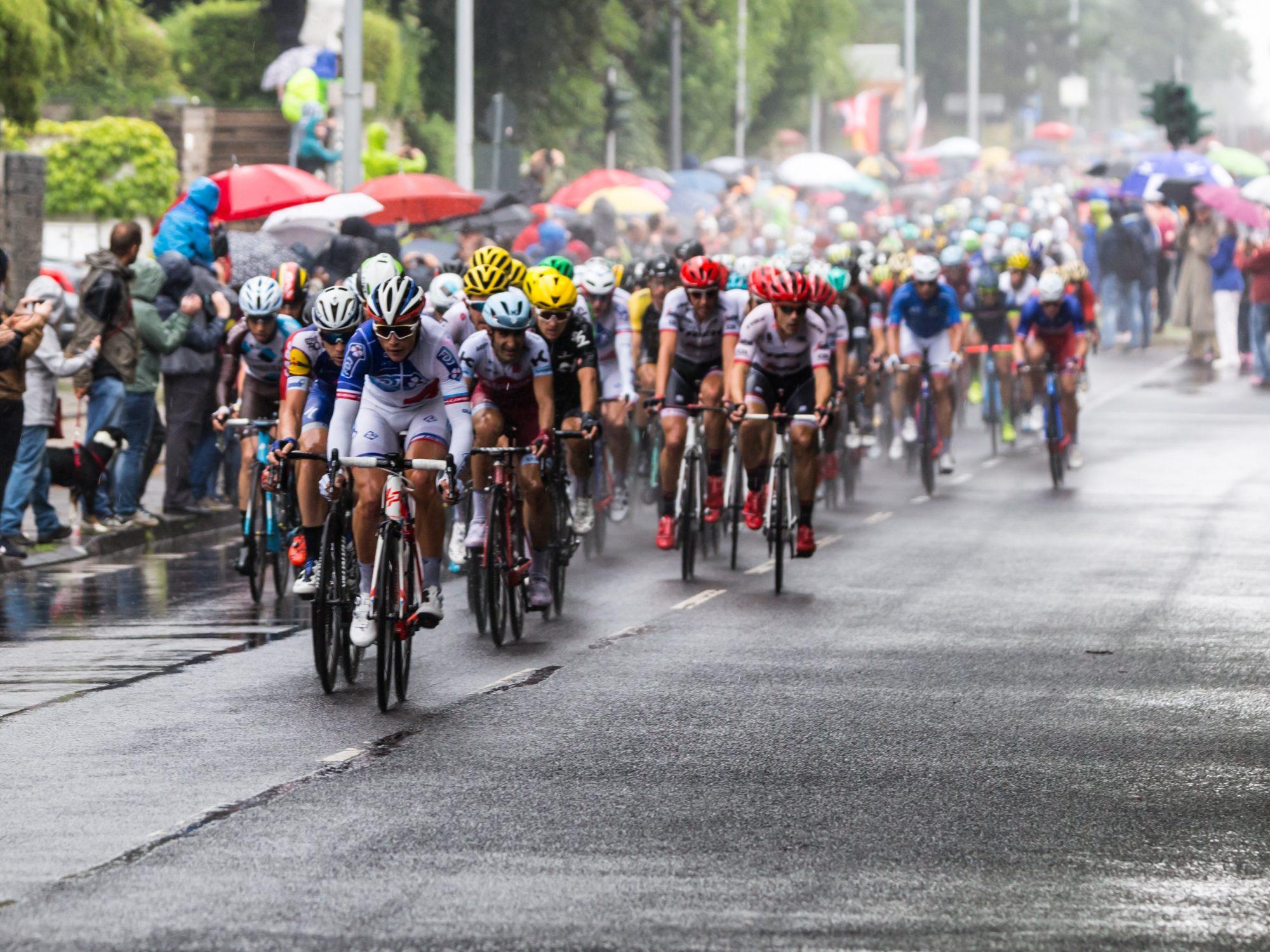 Tour de France peloton in rainy weather.